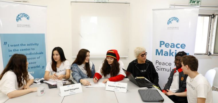 .Dozens of Israeli, Palestinian and international 11th graders in peace talk simulations
